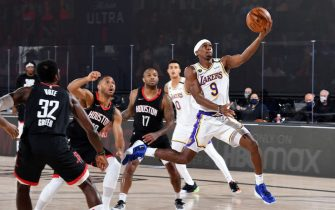 ORLANDO, FL - SEPTEMBER 8: Rajon Rondo #9 of the Los Angeles Lakers drives to the basket during the game against the Houston Rockets during Game Three of the Western Conference Semifinals of the NBA Playoffs on September 8, 2020 at The AdventHealth Arena at ESPN Wide World Of Sports Complex in Orlando, Florida. NOTE TO USER: User expressly acknowledges and agrees that, by downloading and/or using this Photograph, user is consenting to the terms and conditions of the Getty Images License Agreement. Mandatory Copyright Notice: Copyright 2020 NBAE (Photo by Andrew D. Bernstein/NBAE via Getty Images)