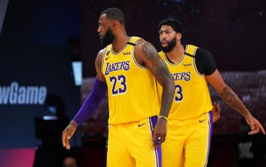ORLANDO, FL - SEPTEMBER 10: LeBron James #23 of the Los Angeles Lakers and Anthony Davis #3 of the Los Angeles Lakers talk during a game against the Houston Rockets during Game Four of the Western Conference Semifinals on September 10, 2020 at the AdventHealth Arena at ESPN Wide World Of Sports Complex in Orlando, Florida. NOTE TO USER: User expressly acknowledges and agrees that, by downloading and/or using this Photograph, user is consenting to the terms and conditions of the Getty Images License Agreement. Mandatory Copyright Notice: Copyright 2020 NBAE (Photo by Jesse D. Garrabrant/NBAE via Getty Images)