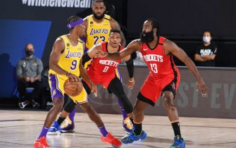 ORLANDO, FL - SEPTEMBER 10: Rajon Rondo #9 of the Los Angeles Lakers handles the ball while James Harden #13 of the Houston Rockets plays defense during Game Four of the Western Conference Semifinals of the NBA Playoffs on September 10, 2020 at The AdventHealth Arena at ESPN Wide World Of Sports Complex in Orlando, Florida. NOTE TO USER: User expressly acknowledges and agrees that, by downloading and/or using this Photograph, user is consenting to the terms and conditions of the Getty Images License Agreement. Mandatory Copyright Notice: Copyright 2020 NBAE (Photo by Andrew D. Bernstein/NBAE via Getty Images)