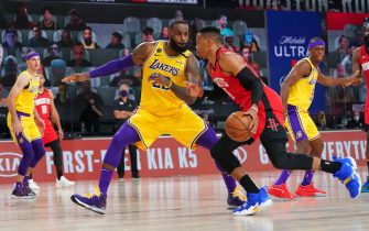ORLANDO, FL - SEPTEMBER 10: LeBron James #23 of the Los Angeles Lakers plays defense against Russell Westbrook #0 of the Houston Rockets during Game Four of the Western Conference Semifinals on September 10, 2020 at the AdventHealth Arena at ESPN Wide World Of Sports Complex in Orlando, Florida. NOTE TO USER: User expressly acknowledges and agrees that, by downloading and/or using this Photograph, user is consenting to the terms and conditions of the Getty Images License Agreement. Mandatory Copyright Notice: Copyright 2020 NBAE (Photo by Jesse D. Garrabrant/NBAE via Getty Images)
