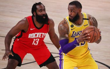 LAKE BUENA VISTA, FLORIDA - SEPTEMBER 10: LeBron James #23 of the Los Angeles Lakers drives the ball against James Harden #13 of the Houston Rockets during the fourth quarter in Game Four of the Western Conference Second Round during the 2020 NBA Playoffs at AdventHealth Arena at the ESPN Wide World Of Sports Complex on September 10, 2020 in Lake Buena Vista, Florida. NOTE TO USER: User expressly acknowledges and agrees that, by downloading and or using this photograph, User is consenting to the terms and conditions of the Getty Images License Agreement.  (Photo by Michael Reaves/Getty Images)