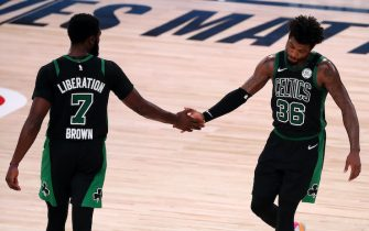LAKE BUENA VISTA, FLORIDA - SEPTEMBER 11: Jaylen Brown #7 of the Boston Celtics and Marcus Smart #36 of the Boston Celtics react during the fourth quarter against the Toronto Raptors in Game Seven of the Eastern Conference Second Round during the 2020 NBA Playoffs at AdventHealth Arena at the ESPN Wide World Of Sports Complex on September 11, 2020 in Lake Buena Vista, Florida. NOTE TO USER: User expressly acknowledges and agrees that, by downloading and or using this photograph, User is consenting to the terms and conditions of the Getty Images License Agreement.  (Photo by Michael Reaves/Getty Images)