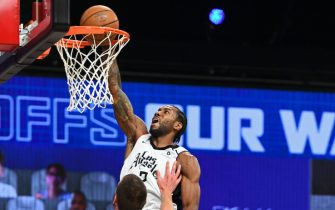 ORLANDO, FL - SEPTEMBER 11: Kawhi Leonard #2 of the LA Clippers dunks the ball against the Denver Nuggets during Game Five of the Western Conference Semifinals of the NBA Playoffs on September 11, 2020 in Orlando, Florida at The Field House. NOTE TO USER: User expressly acknowledges and agrees that, by downloading and/or using this photograph, user is consenting to the terms and conditions of the Getty Images License Agreement.  Mandatory Copyright Notice: Copyright 2020 NBAE (Photo by Garrett Ellwood/NBAE via Getty Images)