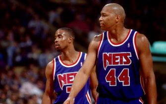 BOSTON, MA - 1993: Derrick Coleman #44 and Kenny Anderson #7 of the New Jersey Nets wait to resume play against the Boston Celtics during a game played at the Boston Garden in Boston, Massachusetts circa 1993. NOTE TO USER: User expressly acknowledges and agrees that, by downloading and or using this photograph, User is consenting to the terms and conditions of the Getty Images License Agreement. Mandatory Copyright Notice: Copyright 1993 NBAE (Photo by Dick Raphael/NBAE via Getty Images)