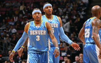 EAST RUTHERFORD, NJ - MARCH 21: Allen Iverson #3 and Carmelo Anthony #15 of the Denver Nuggets walk toward the foul-line during the game against the New Jersey Nets on March 21, 2008 at the Izod Center in East Rutherford, New Jersey. NOTE TO USER: User expressly acknowledges and agrees that, by downloading and or using this Photograph, user is consenting to the terms and conditions of the Getty Images License Agreement. Mandatory Copyright Notice: Copyright 2008 NBAE (Photo by Jesse D. Garrabrant/NBAE via Getty Images)