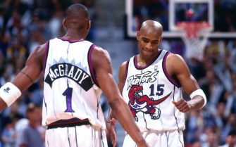 TORONTO - 1999: Tracy McGrady #1 and Vince Carter #15 of the Toronto Raptors look on circa 1999 at the Air Canada Centre in Toronto, Ontario. NOTE TO USER: User expressly acknowledges and agrees that, by downloading and or using this photograph, User is consenting to the terms and conditions of the Getty Images License Agreement. Mandatory Copyright Notice: Copyright 1999 NBAE (Photo by Ron Turenne/NBAE via Getty Images)