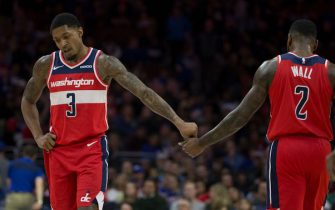 PHILADELPHIA, PA - NOVEMBER 30: Bradley Beal #3 of the Washington Wizards slaps hands with John Wall #2 against the Philadelphia 76ers at the Wells Fargo Center on November 30, 2018 in Philadelphia, Pennsylvania. NOTE TO USER: User expressly acknowledges and agrees that, by downloading and or using this photograph, User is consenting to the terms and conditions of the Getty Images License Agreement. (Photo by Mitchell Leff/Getty Images)