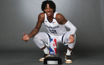 EADS, TN - SEPTEMBER 3:  Ja Morant #12 of the Memphis Grizzlies holds the Eddie Gottlieb Trophy for a portrait after being named the 2019-20 Kia NBA Rookie of the Year on September 3, 2020 in Eads, Tennessee. NOTE TO USER: User expressly acknowledges and agrees that, by downloading and/or using this photograph, user is consenting to the terms and conditions of the Getty Images License Agreement. Mandatory Copyright Notice: Copyright 2020 NBAE (Photo by Joe Murphy/NBAE via Getty Images)