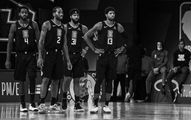 ORLANDO, FL - SEPTEMBER 15: (EDITORS NOTE this image has been converted to black and white) The LA Clippers stand on the court during Game Seven of the Western Conference Semifinals of the NBA Playoffs against the Denver Nuggets on September 15, 2020 in Orlando, Florida at AdventHealth Arena. NOTE TO USER: User expressly acknowledges and agrees that, by downloading and/or using this photograph, user is consenting to the terms and conditions of the Getty Images License Agreement. Mandatory Copyright Notice: Copyright 2020 NBAE (Photo by Garrett Ellwood/NBAE via Getty Images)