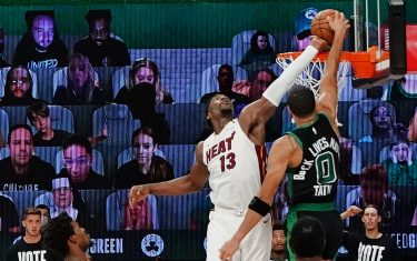 ORLANDO, FL - SEPTEMBER 15: Bam Adebayo #13 of the Miami Heat blocks a dunk attempt in the game against Jayson Tatum #0 of the Boston Celtics during Game One of the Eastern Conference Finals of the NBA Playoffs on September 15, 2020 at The Field House at ESPN Wide World Of Sports Complex in Orlando, Florida. NOTE TO USER: User expressly acknowledges and agrees that, by downloading and/or using this Photograph, user is consenting to the terms and conditions of the Getty Images License Agreement. Mandatory Copyright Notice: Copyright 2020 NBAE (Photo by Jesse D. Garrabrant/NBAE via Getty Images)