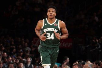 NEW YORK, NY - DECEMBER 21: Giannis Antetokounmpo #34 of the Milwaukee Bucks looks on during the game against the New York Knicks on December 21, 2019 at Madison Square Garden in New York City, New York.  NOTE TO USER: User expressly acknowledges and agrees that, by downloading and or using this photograph, User is consenting to the terms and conditions of the Getty Images License Agreement. Mandatory Copyright Notice: Copyright 2019 NBAE  (Photo by Nathaniel S. Butler/NBAE via Getty Images)