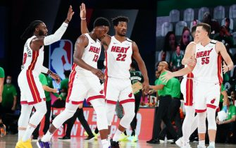 ORLANDO, FL - SEPTEMBER 17: Jae Crowder #99 of the Miami Heat and Jimmy Butler #22 of the Miami Heat high-five during a game against the Boston Celtics during Game Two of the Eastern Conference Finals of the NBA Playoffs on September 17, 2020 at the AdventHealth Arena at ESPN Wide World Of Sports Complex in Orlando, Florida. NOTE TO USER: User expressly acknowledges and agrees that, by downloading and/or using this Photograph, user is consenting to the terms and conditions of the Getty Images License Agreement. Mandatory Copyright Notice: Copyright 2020 NBAE (Photo by Jesse D. Garrabrant/NBAE via Getty Images)