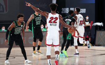 ORLANDO, FL - SEPTEMBER 17: Jimmy Butler #22 of the Miami Heat handles the ball while Marcus Smart #36 of the Boston Celtics plays defense during Game Two of the Eastern Conference Finals of the NBA Playoffs on September 17, 2020 at The AdventHealth Arena at ESPN Wide World Of Sports Complex in Orlando, Florida. NOTE TO USER: User expressly acknowledges and agrees that, by downloading and/or using this Photograph, user is consenting to the terms and conditions of the Getty Images License Agreement. Mandatory Copyright Notice: Copyright 2020 NBAE (Photo by Nathaniel S. Butler/NBAE via Getty Images)