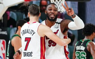 ORLANDO, FL - SEPTEMBER 17: Goran Dragic #7 of the Miami Heat and Jae Crowder #99 of the Miami Heat hug during a game against the Boston Celtics during Game Two of the Eastern Conference Finals of the NBA Playoffs on September 17, 2020 at the AdventHealth Arena at ESPN Wide World Of Sports Complex in Orlando, Florida. NOTE TO USER: User expressly acknowledges and agrees that, by downloading and/or using this Photograph, user is consenting to the terms and conditions of the Getty Images License Agreement. Mandatory Copyright Notice: Copyright 2020 NBAE (Photo by Jesse D. Garrabrant/NBAE via Getty Images)