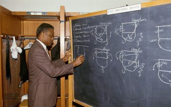 BOSTON - 1987:  Head coach K.C. Jones of the Boston Celtics draws up plays on the blackboard prior to a NBA game at the Boston Garden in 1987 in Boston, Massachusetts.  NOTE TO USER:  User expressly acknowledges and agrees that, by downloading and/or using this Photograph, user is consenting to the terms and conditions of the Getty Images License Agreement.  Mandatory Copyright Notice: Copyright 1987 NBAE (Photo by Andrew D. Bernstein/NBAE via Getty Images) *** Local Caption *** K.C. Jones