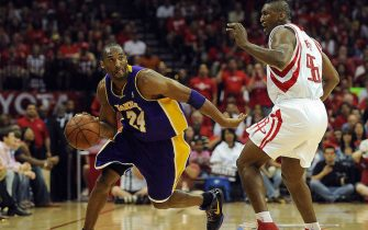 HOUSTON - MAY 10:  Guard Kobe Bryant #24 of the Los Angeles Lakers dribbles the ball past Ron Artest #96 of the Houston Rockets in Game Four of the Western Conference Semifinals during the 2009 NBA Playoffs at Toyota Center on May 10, 2009 in Houston, Texas. NOTE TO USER: User expressly acknowledges and agrees that, by downloading and or using this photograph, User is consenting to the terms and conditions of the Getty Images License Agreement.  (Photo by Ronald Martinez/Getty Images)