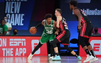 ORLANDO, FL - SEPTEMBER 19: Marcus Smart #36 of the Boston Celtics handles the ball against the Miami Heat during Game Two of the Eastern Conference Finals of the NBA Playoffs on September 19, 2020 at the AdventHealth Arena at ESPN Wide World Of Sports Complex in Orlando, Florida. NOTE TO USER: User expressly acknowledges and agrees that, by downloading and/or using this Photograph, user is consenting to the terms and conditions of the Getty Images License Agreement. Mandatory Copyright Notice: Copyright 2020 NBAE (Photo by Jesse D. Garrabrant/NBAE via Getty Images)