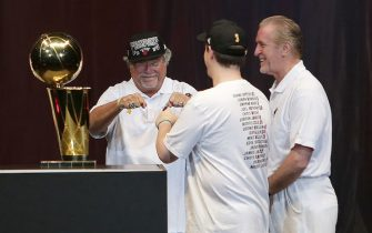 MIAMI, FL - JUNE 24: Micky Arison, Nick Arison and Pat Riley of the Miami Heat celebrates the NBA Championship victory rally at the AmericanAirlines Arena on June 24, 2013 in Miami, Florida. The Miami Heat defeated the San Antonio Spurs in the NBA Finals.  (Photo by Alexander Tamargo/Getty Images)