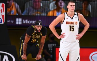 ORLANDO, FL - SEPTEMBER 20: Anthony Davis #3 of the Los Angeles Lakers and Nikola Jokic #15 of the Denver Nuggets looks on during Game Two of the Western Conference Finals on September 20, 2020 in Orlando, Florida at AdventHealth Arena. NOTE TO USER: User expressly acknowledges and agrees that, by downloading and/or using this Photograph, user is consenting to the terms and conditions of the Getty Images License Agreement. Mandatory Copyright Notice: Copyright 2020 NBAE (Photo by Garrett Ellwood/NBAE via Getty Images)