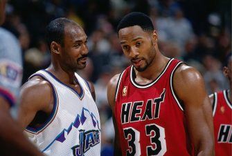 SALT LAKE CITY - JANUARY 4:  Karl Malone #32 of the Utah Jazz talks to Alonzo Mouning #33 of the Miami Heat during an NBA game on January 4, 1997 in Salt Lake City, Utah.  NOTE TO USER: User expressly acknowledges and agrees that, by downloading and/or using this Photograph, User is consenting to the terms and conditions of the Getty Images License Agreement. Mandatory Copyright Notice: Copyright 1997 NBAE (Photo by Andy Hayt/NBAE via Getty Images)
