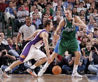 DALLAS - MARCH 14:  Steve Nash #13 of the Phoenix Suns drives the ball against Dirk Nowitzki #41 of the Dallas Mavericks on March 14, 2007 at the American Airlines Center in Dallas, Texas.  NOTE TO USER: User expressly acknowledges and agrees that, by downloading and/or using this Photograph, user is consenting to the terms and conditions of the Getty Images License Agreement. Mandatory Copyright Notice: Copyright 2007 NBAE  (Photo by Tim Heitman/NBAE via Getty Images)