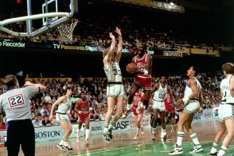 BOSTON - APRIL 20:  Michael Jordan #23 of the Chicago Bulls drives to the basket against Larry Bird #33 of the Boston Celtics during Game 2 of the Eastern Conference quarterfinals during the 1986 NBA Playoffs on April 20, 1986 at the Boston Garden in Boston, Massachusetts. The Celtics defeated the Bulls, 135-131 in double-overtime. NOTE TO USER: User expressly acknowledges and agrees that, by downloading and/or using this Photograph, user is consenting to the terms and conditions of the Getty Images License Agreement. Mandatory Copyright Notice: Copyright 2004 NBAE (Photo by Dick Raphael/NBAE via Getty Images)