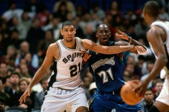 SAN ANTONIO - 1998:  Kevin Garnett #21 of the Minnesota Timberwolves defends against Tim Duncan #21 of the San Antonio Spurs during a 1998 NBA game at the Alamo Dome in San Antonio, Texas. NOTE TO USER: User expressly acknowledges that, by downloading and or using this photograph, User is consenting to the terms and conditions of the Getty Images License agreement. Mandatory Copyright Notice: Copyright 1998 NBAE (Photo by Barry Gossage/NBAE via Getty Images)