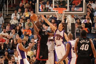 PHOENIX - DECEMBER 10:  Steve Nash #13 of the Phoenix Suns tries to block the shot of Shaquille O'Neal #32 of the Miami Heat in NBA action December 10, 2007 at U.S. Airways Center in Phoenix, Arizona. NOTE TO USER: User expressly acknowledges and agrees that, by downloading and or using this Photograph, user is consenting to the terms and conditions of the Getty Images License Agreement. Mandatory Copyright Notice: Copyright 2007 NBAE (Photo by Andrew D. Bernstein/NBAE via Getty Images)