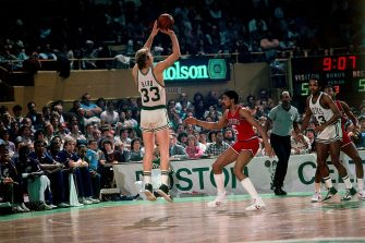 "BOSTON - 1984:  Larry Bird #33 of the Boston Celtics shoots the jumper against Julius "" Dr. J"" Erving #6 of the Philadelphia 76ers during a game played in 1984 at the Boston Garden in Boston, Massachusetts. NOTE TO USER: User expressly acknowledges and agrees that, by downloading and or using this photograph, User is consenting to the terms and conditions of the Getty Images License Agreement. Mandatory Copyright Notice: Copyright 1984 NBAE (Photo by Dick Raphael/NBAE via Getty Images)"