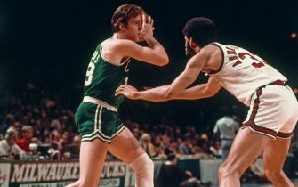MILWAUKEE, WI - FEBRUARY 6: Kareem Abdul-Jabbar #33 of the Milwaukee Bucks defends as Dave Dowens #18 of the Boston Celtics handles the ball on February 6, 1974 at the MECCA Arena in Milwaukee, Wisconsin. NOTE TO USER: User expressly acknowledges and agrees that, by downloading and/or using this photograph, user is consenting to the terms and conditions of the Getty Images License Agreement. Mandatory Copyright Notice: Copyright 1974 NBAE (Photo by Vernon Biever/NBAE via Getty Images)