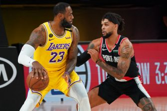 ORLANDO, FL - AUGUST 29: LeBron James #23 of the Los Angeles Lakers handles the ball against the Portland Trail Blazers during Round One, Game Five of the NBA Playoffs on August 29, 2020 at the AdventHealth Arena at ESPN Wide World Of Sports Complex in Orlando, Florida. NOTE TO USER: User expressly acknowledges and agrees that, by downloading and/or using this Photograph, user is consenting to the terms and conditions of the Getty Images License Agreement. Mandatory Copyright Notice: Copyright 2020 NBAE (Photo by Jesse D. Garrabrant/NBAE via Getty Images)