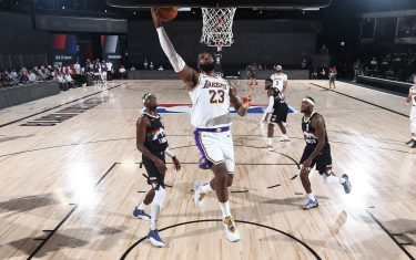 ORLANDO, FL - SEPTEMBER 22: LeBron James #23 of the Los Angeles Lakers shoots the ball against the Denver Nuggets during Game Three of the Western Conference Finals on September 22, 2020 in Orlando, Florida at AdventHealth Arena. NOTE TO USER: User expressly acknowledges and agrees that, by downloading and/or using this Photograph, user is consenting to the terms and conditions of the Getty Images License Agreement. Mandatory Copyright Notice: Copyright 2020 NBAE (Photo by Nathaniel S. Butler/NBAE via Getty Images)