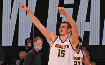 ORLANDO, FL - SEPTEMBER 15: Nikola Jokic #15 of the Denver Nuggets smiles and celebrates as he walks off the court after winning Game Seven of the Western Conference Semifinals against the LA Clippers on September 13, 2020 in Orlando, Florida at AdventHealth Arena. NOTE TO USER: User expressly acknowledges and agrees that, by downloading and/or using this Photograph, user is consenting to the terms and conditions of the Getty Images License Agreement. Mandatory Copyright Notice: Copyright 2020 NBAE (Photo by Madison Quisenberry/NBAE via Getty Images)