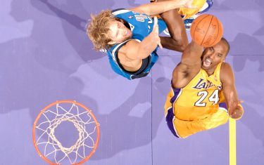 LOS ANGELES - OCTOBER 30:  Kobe Bryant #24 of the Los Angeles Lakers goes up for a dunk against Dirk Nowitzki #41 of the Dallas Mavericks at Staples Center on October 30, 2009 in Los Angeles, California. NOTE TO USER: User expressly acknowledges and agrees that, by downloading and/or using this Photograph, user is consenting to the terms and conditions of the Getty Images License Agreement. Mandatory Copyright Notice: Copyright 2009 NBAE (Photo by Andrew D. Bernstein/NBAE via Getty Images)