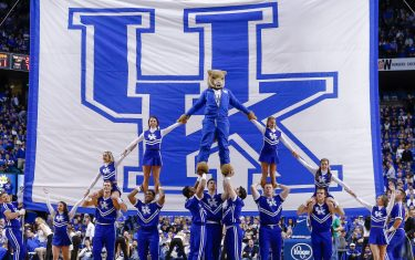 LEXINGTON, KY - JANUARY 31: Members of the Kentucky Wildcats cheerleading team pose in front of the University of Kentucky flag during the game against the Alabama Crimson Tide at Rupp Arena on January 31, 2015 in Lexington, Kentucky. (Photo by Michael Hickey/Getty Images)