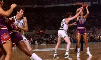 BOSTON - 1976:  Alvan Adams #33 of the Phoenix Suns passes against Dave Cowens #18 of the Boston Celtics during a game in the 1976 NBA Finals played at the Boston Garden in Boston, Massachusetts. The Boston Celtics defeated the Phoenix Suns 4-2 and won the the 1976 NBA Championship. NOTE TO USER: User expressly acknowledges and agrees that, by downloading and or using this photograph, User is consenting to the terms and conditions of the Getty Images License Agreement. Mandatory Copyright Notice: Copyright 1976 NBAE (Photo by Dick Raphael/NBAE via Getty Images)