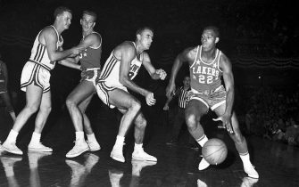 (Original Caption) 11/10/59-ST. LOUIS: Minneapolis Lakers' Elgin Baylor (22) moves in for another tally in 1st quarter action here 11/10 night against St. Louis Hawks. Baylor recently set NBA record with 64 points.