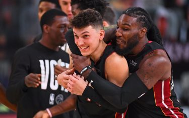 ORLANDO, FL - SEPTEMBER 23: Jae Crowder #99 and Tyler Herro #14 of the Miami Heat smile and celebrate on the court after Game Four of the Eastern Conference Finals against the Boston Celtics on September 23, 2020 in Orlando, Florida at AdventHealth Arena. NOTE TO USER: User expressly acknowledges and agrees that, by downloading and/or using this Photograph, user is consenting to the terms and conditions of the Getty Images License Agreement. Mandatory Copyright Notice: Copyright 2020 NBAE (Photo by Garrett Ellwood/NBAE via Getty Images)