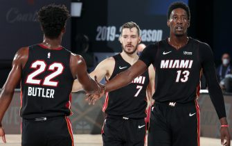 ORLANDO, FL - SEPTEMBER 23: Jimmy Butler #22 of the Miami Heat,Goran Dragic #7 of the Miami Heat, and Bam Adebayo #13 of the Miami Heat high five during the game against the Boston Celtics during Game Four of the Eastern Conference Finals of the NBA Playoffs on September 23, 2020 at The AdventHealth Arena at ESPN Wide World Of Sports Complex in Orlando, Florida. NOTE TO USER: User expressly acknowledges and agrees that, by downloading and/or using this Photograph, user is consenting to the terms and conditions of the Getty Images License Agreement. Mandatory Copyright Notice: Copyright 2020 NBAE (Photo by Nathaniel S. Butler/NBAE via Getty Images)
