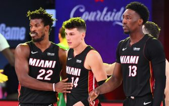 ORLANDO, FL - SEPTEMBER 23: Jimmy Butler #22, Tyler Herro #14 and Bam Adebayo #13 of the Miami Heat walk off the court after Game Four of the Eastern Conference Finals against the Boston Celtics on September 23, 2020 in Orlando, Florida at AdventHealth Arena. NOTE TO USER: User expressly acknowledges and agrees that, by downloading and/or using this Photograph, user is consenting to the terms and conditions of the Getty Images License Agreement. Mandatory Copyright Notice: Copyright 2020 NBAE (Photo by Garrett Ellwood/NBAE via Getty Images)