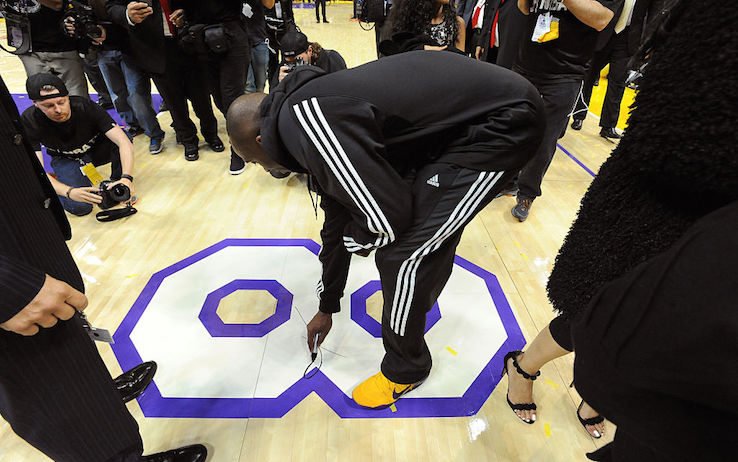 LOS ANGELES, CA - APRIL 13:  Kobe Bryant #24 of the Los Angeles Lakers signs the court after his last game against the Utah Jazz at STAPLES Center on April 13, 2016 in Los Angeles, California. NOTE TO USER: User expressly acknowledges and agrees that, by downloading and/or using this Photograph, user is consenting to the terms and conditions of the Getty Images License Agreement. Mandatory Copyright Notice: Copyright 2016 NBAE (Photo by Andrew D. Bernstein/NBAE via Getty Images)