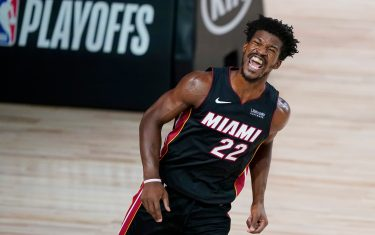 LAKE BUENA VISTA, FLORIDA - AUGUST 18:  Jimmy Butler #22 of the Miami Heat reacts after dunking against the Indiana Pacers during the second half at AdventHealth Arena at ESPN Wide World Of Sports Complex on August 18, 2020 in Lake Buena Vista, Florida. NOTE TO USER: User expressly acknowledges and agrees that, by downloading and or using this photograph, User is consenting to the terms and conditions of the Getty Images License Agreement. (Photo by Ashley Landis-Pool/Getty Images)