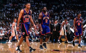 SAN ANTONIO - JUNE 16:  Allan Houston #20 and Larry Johnson #2 of the New York Knicks walk off the court  during Game One of the 1999 NBA Finals played on June 16, 1999 at the Alamodome in San Antonio, Texas.  NOTE TO USER: User expressly acknowledges that, by downloading and or using this photograph, User is consenting to the terms and conditions of the Getty Images License agreement. Mandatory Copyright Notice: Copyright 1999 NBAE (Photo by Nathaniel S. Butler/NBAE via Getty Images)