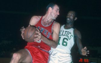 BOSTON, MA - CIRCA 1965: Tom Sanders #16 of the Boston Celtics guards Bob Pettit #9 of the St. Louis Hawks during an NBA basketball game circa 1965 at the Boston Garden in Boston, Massachusetts. Sanders played for the Celtics from 1960-73. (Photo by Focus on Sport/Getty Images) *** Local Caption *** Tom Sanders; Bob Pettit