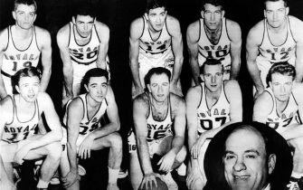 ROCHESTER -  NEW YORK - 1951: The World Champions of basketball, the Rochester Royals pose for a team portrait in 1951 front row (L-R): Bob Davies, Bob Wanzer, William Holtzman, Paul Noel, Frank Saul, Rear row: Bill Calhoun, Joe McNamee, Arnold Risen, Jack Coleman, Arnold Johnson, inset head coach Lester Harrison in Rochester, New York. NOTE TO USER: User expressly acknowledges  and agrees that, by downloading and or using this  photograph, User is consenting to the terms and conditions of the Getty Images License Agreement. Mandatory copyright notice: Copyright NBAE 2002 (Photo by NBAPhotos/ NBAE/ Getty Images)