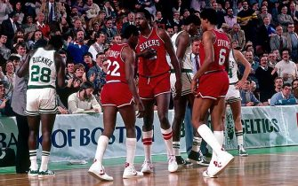 BOSTON - 1983:  Andrew Toney #22, Moses Malone #2 and Julius Erving #6 of the Philadelphia 76ers huddle on the court during a game played in 1983 at the Boston Garden in Boston, Massachusetts.  NOTE TO USER: User expressly acknowledges that, by downloading and or using this photograph, User is consenting to the terms and conditions of the Getty Images License agreement. Mandatory Copyright Notice: Copyright 1983 NBAE (Photo by Dick Raphael/NBAE via Getty Images)