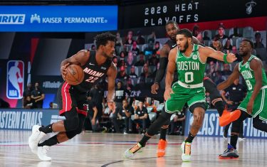 ORLANDO, FL - SEPTEMBER 23: Jimmy Butler #22 of the Miami Heat handles the ball against Jayson Tatum #0 of the Boston Celtics during Game Four of the Eastern Conference Finals of the NBA Playoffs on September 23, 2020 at the AdventHealth Arena at ESPN Wide World Of Sports Complex in Orlando, Florida. NOTE TO USER: User expressly acknowledges and agrees that, by downloading and/or using this Photograph, user is consenting to the terms and conditions of the Getty Images License Agreement. Mandatory Copyright Notice: Copyright 2020 NBAE (Photo by Jesse D. Garrabrant/NBAE via Getty Images)