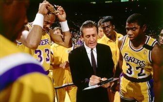 LOS ANGELES - 1989:  Head Coach Pat Riley of the Los Angeles Lakers draws up a play during a timeout for Magic Johnson #32 and Kareem Abdul Jabbar #33 during an NBA game circa 1989 at the Forum in Los Angeles, California.  NOTE TO USER: User expressly acknowledges and agrees that, by downloading and/or using this Photograph, user is consenting to the terms and conditions of the Getty Images License Agreement.  Mandatory Copyright Notice: Copyright 1989 NBAE (Photo by Andrew D. Bernstein/NBAE via Getty Images)