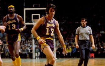 BOSTON - 1972:  Pat Riley #17 of the Los Angeles Lakers moves the ball up court against the Boston Celtics during a game played circa 1972 at the Boston Garden in Boston, Massachusetts. NOTE TO USER: User expressly acknowledges that, by downloading and or using this photograph, User is consenting to the terms and conditions of the Getty Images License agreement. Mandatory Copyright Notice: Copyright 1972 NBAE (Photo by Dick Raphael/NBAE via Getty Images)