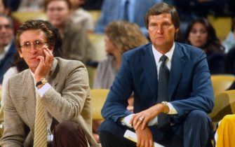 LOS ANGELE, CA - CIRCA 1979:  Head coach Jerry West (R) and assistant coach Pat Riley (L) of the Los Angeles Lakers looks on during an NBA basketball game circa 1979 at The Forum in Inglewood, California. West coached for the Lakers from 1976-79. (Photo by Focus on Sport/Getty Images) *** Local Caption *** Jerry West; Pat Riley
